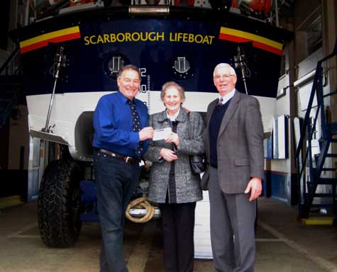 Brian and Rosemarie Raines of Malton present cheques for £400 in celebration of their Golden Wedding Anniversary to Colin Lawson Scarborougnh Lifeboat Operations Manager