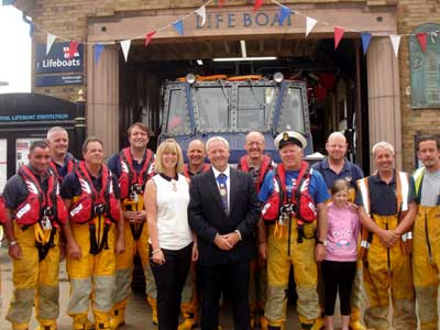 Front row middle is Mayoress Sue Backhouse, Mayor Andrew Bachouse, Coxswain Tom Clark surrounded by crew members and shore helpers